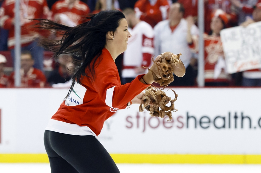 Best detroit red wings pop culture references page 4 apr 27 2015 detroit mi usa ice girl carry octopus off voltagebd Images